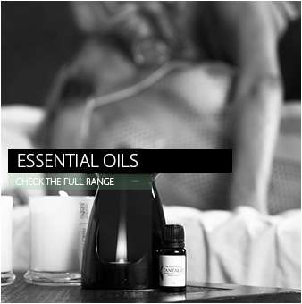 aphrodisiac essential oils and burner with intimate females in background black and white