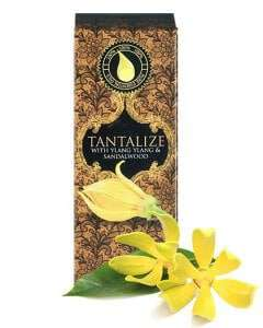 essential oil for love - wildfire tantalize 10ml essenial oil box with ylang ylang flower in the foreground