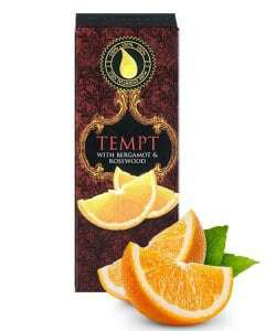 tempt 10ml essential oil box with slice of orange in the foreground